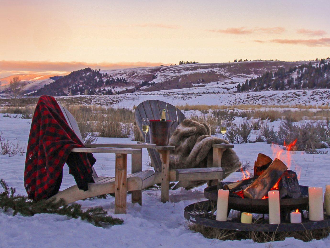adirondack chairs blankets dusk fire Firepit flame Health + Wellness Hotels Spa Retreats sunrise Sunset Trip Ideas wilderness sky outdoor snow Winter weather season mountain