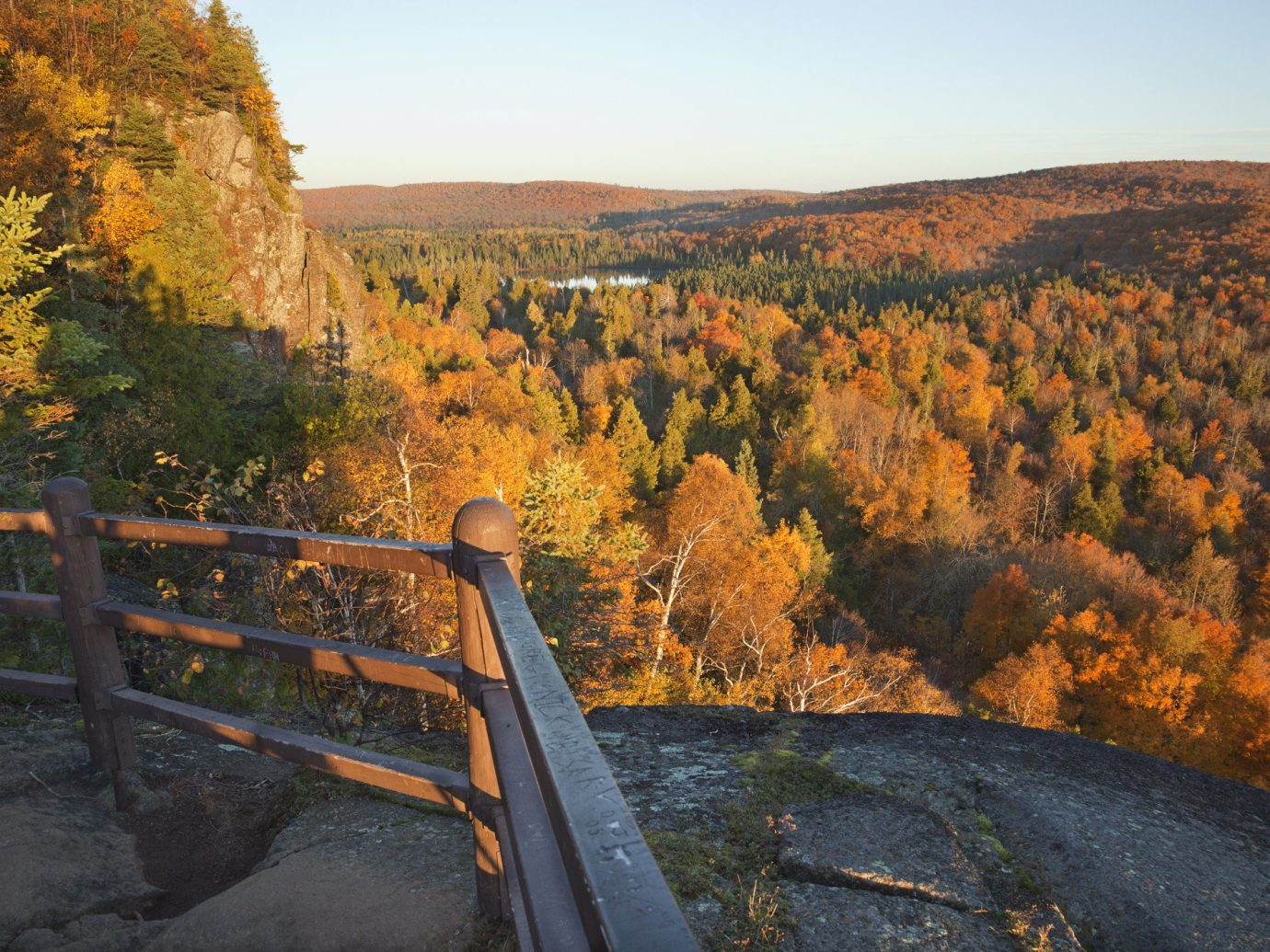 Outdoors + Adventure Road Trips Trip Ideas bench outdoor sky Nature leaf wilderness autumn tree mountain morning national park hill path park plant escarpment state park landscape road evening Forest valley Fence overlooking