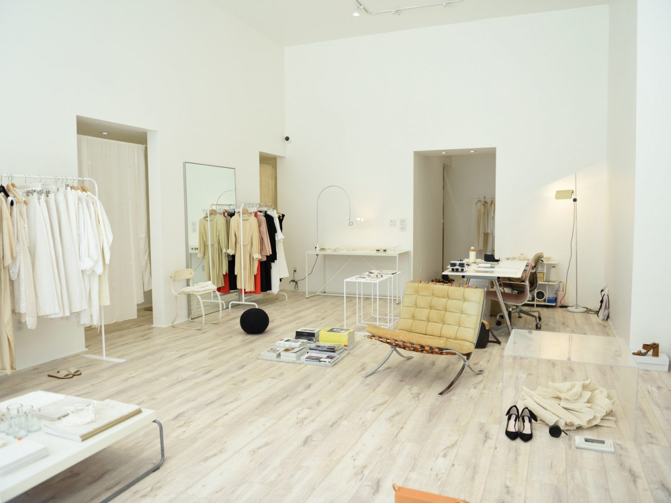 airy apparel Boutique clean clothes clothing Hip interior Luxury neutral tones Shop shopping store Style + Design trendy indoor wall room property floor hardwood home living room interior design flooring wood real estate Design laminate flooring furniture wood flooring apartment Bedroom