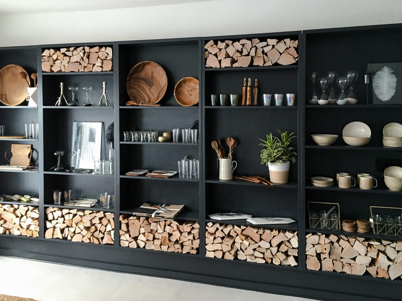 Mountains + Skiing Trip Ideas different shelving indoor furniture shelf interior design display case bookcase product several same entertainment center