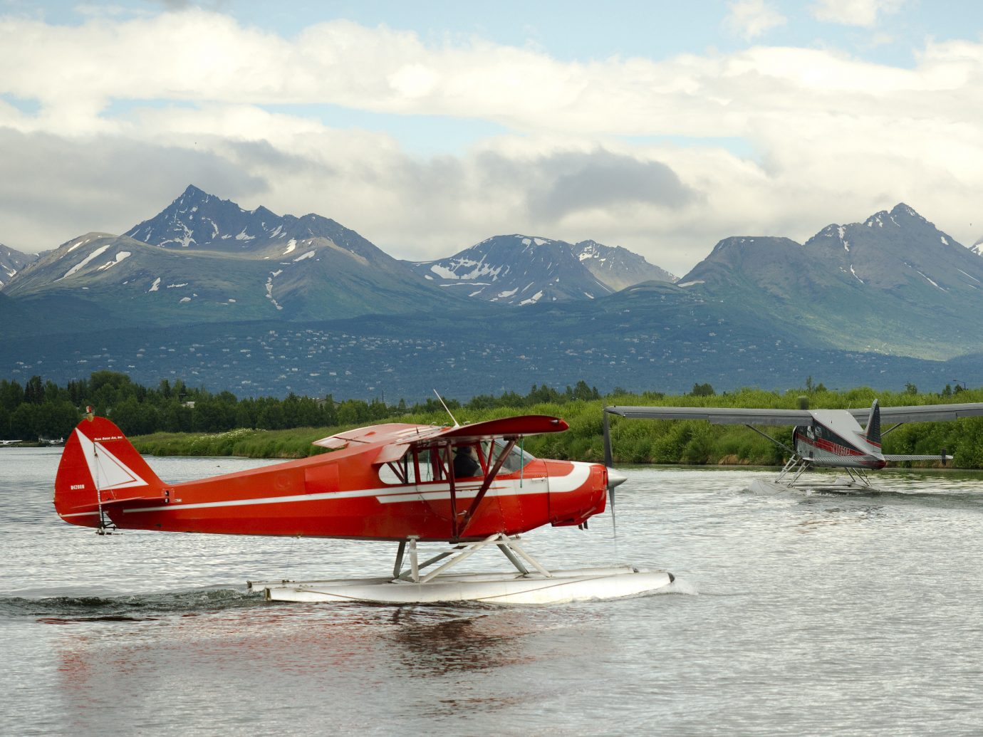 Trip Ideas mountain sky outdoor water aircraft airplane vehicle plane Boat Lake red aviation atmosphere of earth flight seaplane orange