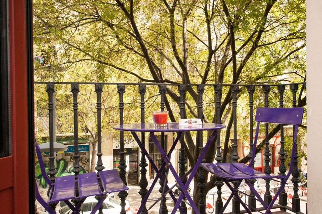 Hotels tree outdoor purple chair home backyard estate spring interior design cottage porch outdoor structure colorful dining table colored
