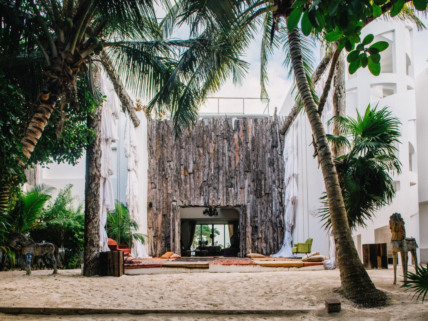 Boutique Hotels Hotels Mexico Tulum arecales palm tree tree plant tourist attraction hacienda building facade tourism