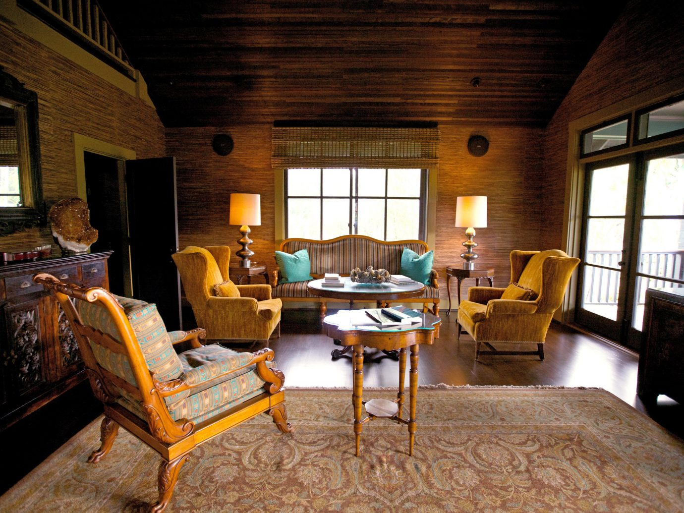 Beach Boutique Hotels Eco Hotels Lounge Luxury Travel Modern Romance floor indoor room Living chair window property estate ceiling building house home living room cottage log cabin furniture hardwood farmhouse interior design Villa real estate wood mansion area