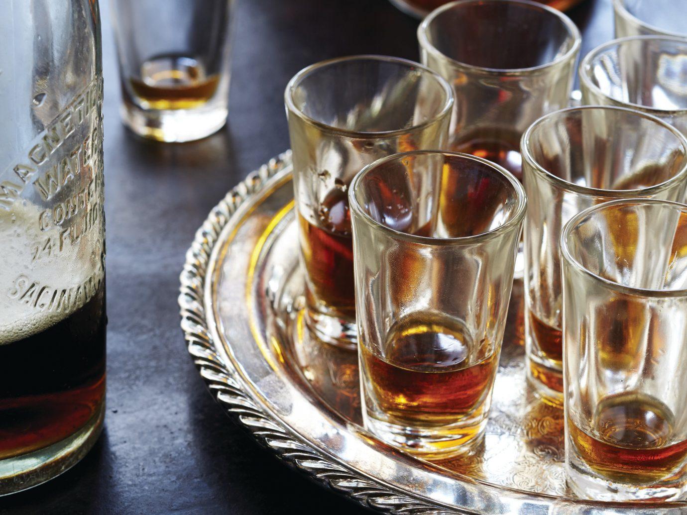 Food + Drink cup table alcoholic beverage Drink distilled beverage beer alcohol whisky liqueur wine glass beverage