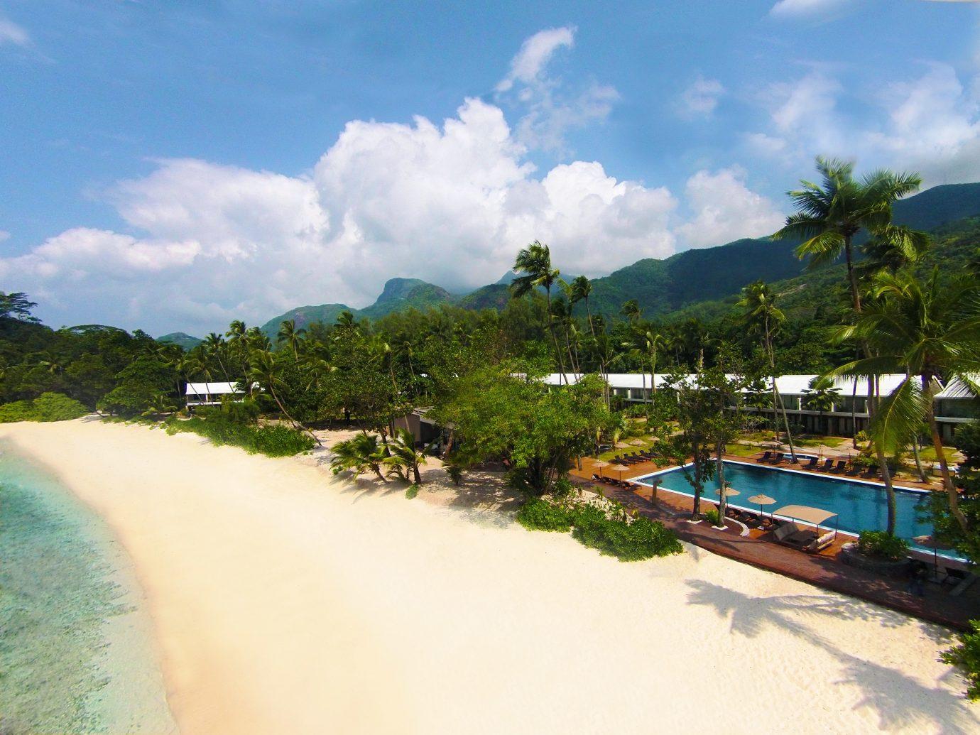 Beach Beachfront Hotels Luxury Pool Tropical sky outdoor Nature body of water Sea vacation Coast mountain bay caribbean Resort tropics Lagoon Island shore