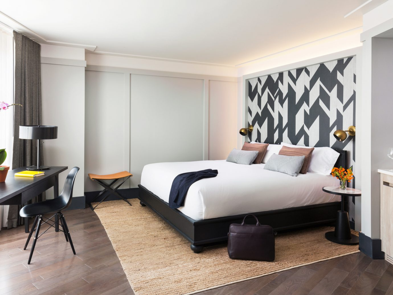 Bedroom City Hip Hotels Modern indoor floor wall room ceiling Living property living room furniture interior design real estate home Design Suite laminate flooring apartment flat window covering wood area decorated