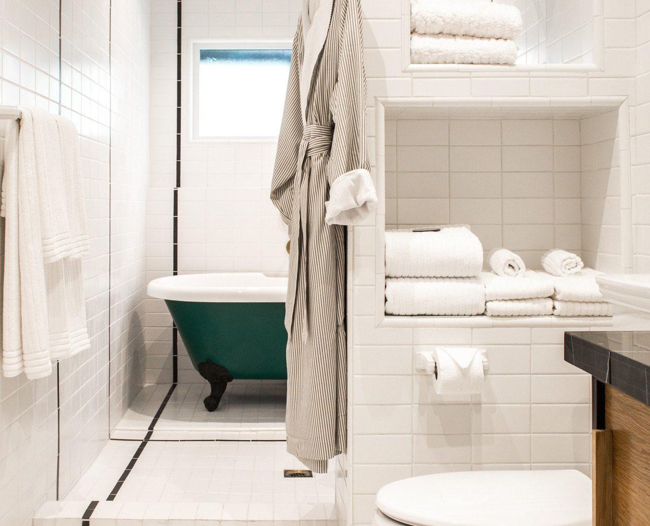 Bath bath robe bathroom Boutique clean Hotels shower white room indoor floor toilet plumbing fixture interior design home flooring bidet Design tile tiled