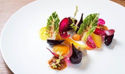 Jetsetter Guides plate food table dish produce plant white salad fruit cuisine meal hors d oeuvre vegetable arranged containing piece de resistance