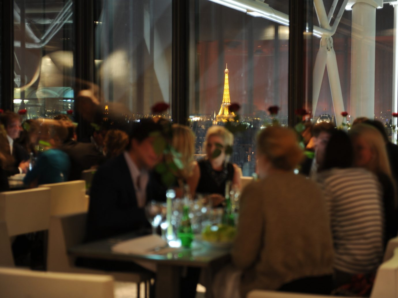 Food + Drink person table indoor people meal group dinner restaurant Bar several