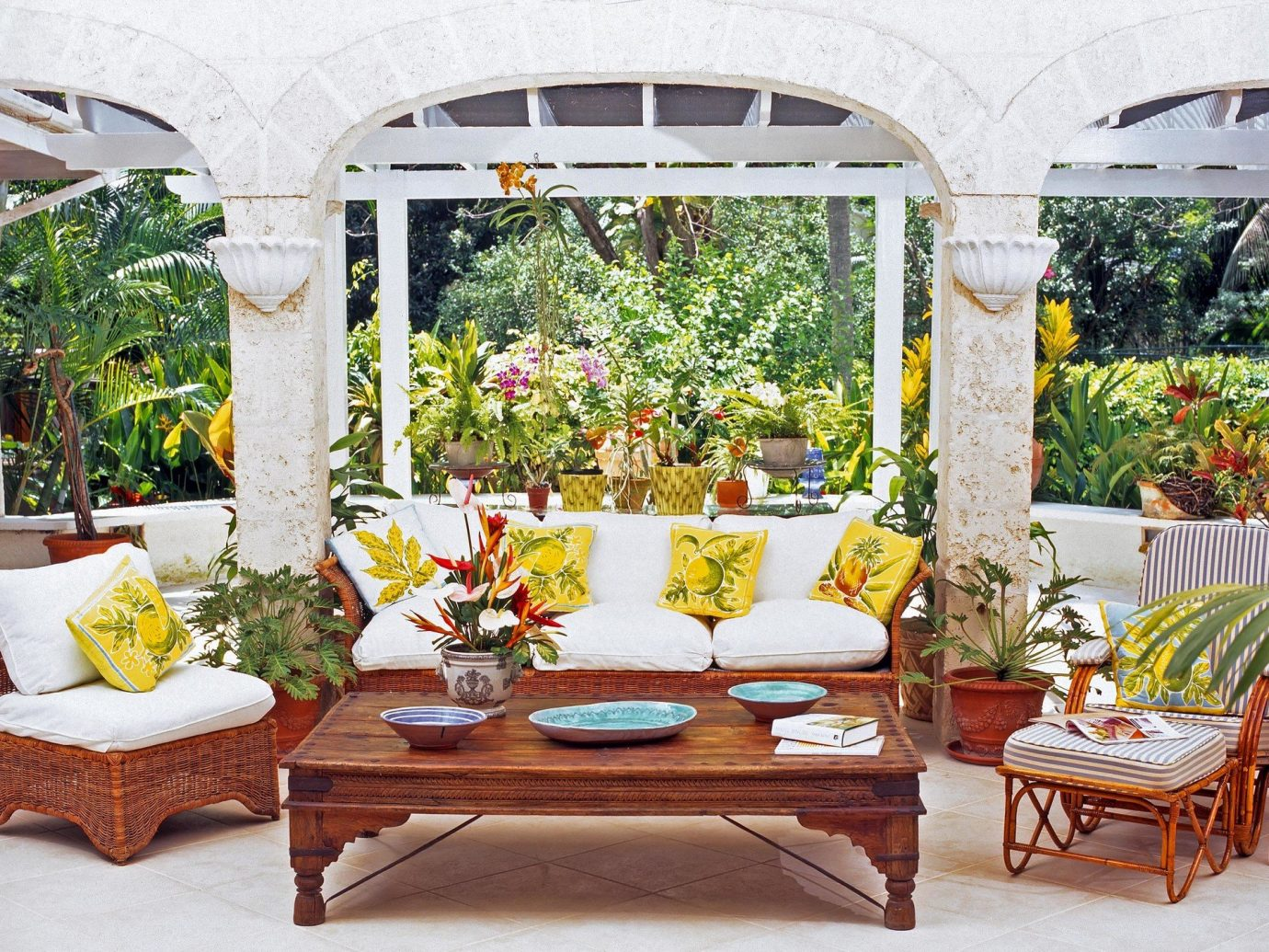 cabana calm decor detail flowers Greenery Hotels lounge chairs Luxury Nature outdoor lounge palm trees remote Scenic views serene trees Tropical building room floristry table porch outdoor structure flower backyard estate furniture window area