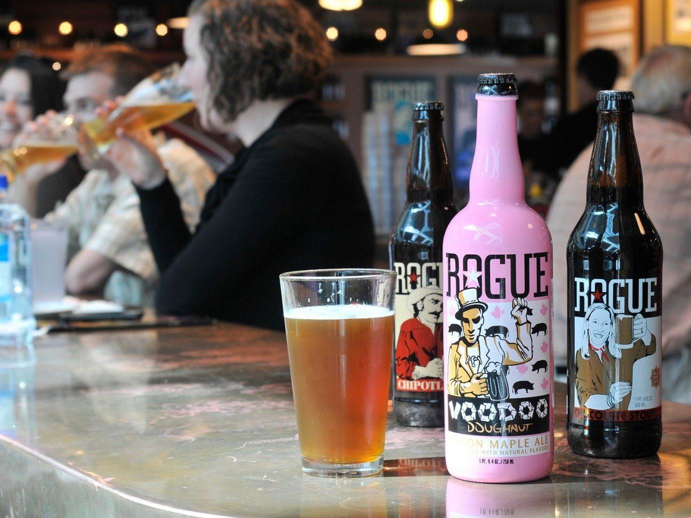 Food + Drink bottle table person Drink alcoholic beverage food beer drinking sense Bar beverage alcohol