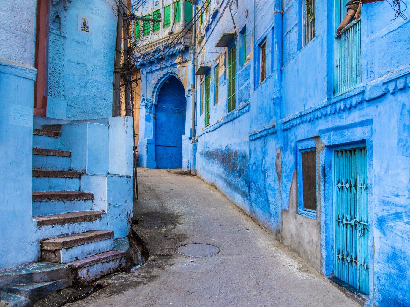 India Jaipur Jodhpur Trip Ideas building blue outdoor alley Town wall neighbourhood street way old facade window sky house road sidewalk dirty