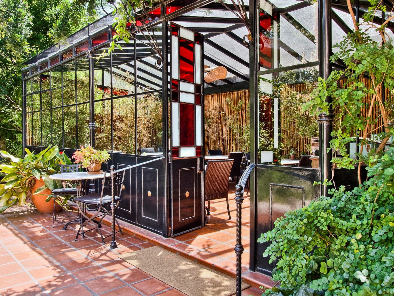 Boutique Hotels Luxury Travel tree outdoor building outdoor structure real estate greenhouse backyard Patio roof pergola Courtyard