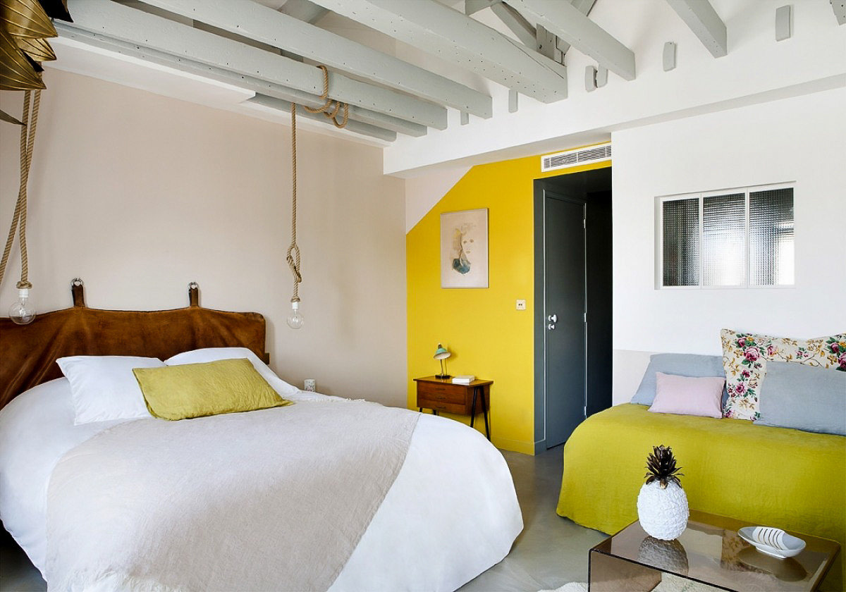 Boutique Hotels Hotels indoor wall room sofa bed yellow floor ceiling hotel property Bedroom interior design Suite Living real estate home house loft pillow estate interior designer furniture lamp decorated
