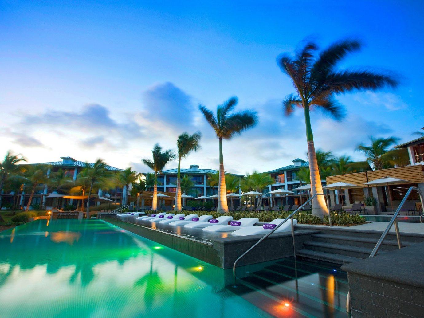 Hotels sky outdoor leisure swimming pool Resort palm vacation Water park marina amusement park estate Beach condominium dock park colorful lined
