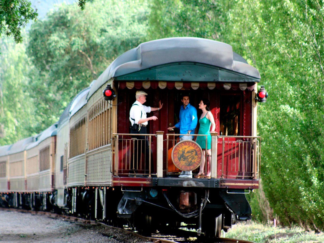 Romance Trip Ideas tree outdoor vehicle track land vehicle transport train rolling stock locomotive rail transport railroad car passenger car traveling railroad