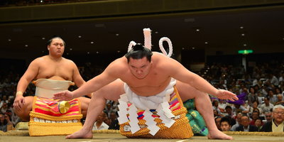 activities Arts + Culture audience colorful crowd Cultural culture Hotels Luxury Travel night people performance show Sport sumo wrestler sumo wrestling tradition traditional wrestling person collegiate wrestling sports combat sport contact sport grappling sumo scholastic wrestling individual sports greco roman wrestling wrestler
