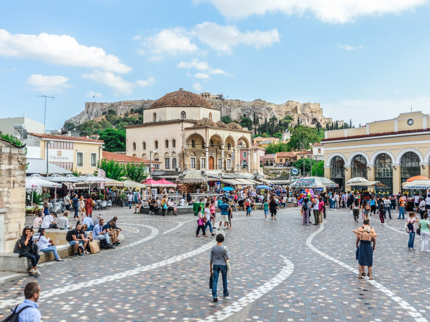 Travel Tips sky building outdoor road Town town square City plaza people public space tourism group tourist attraction recreation pedestrian street Downtown tours ancient rome square stone several colonnade crowd