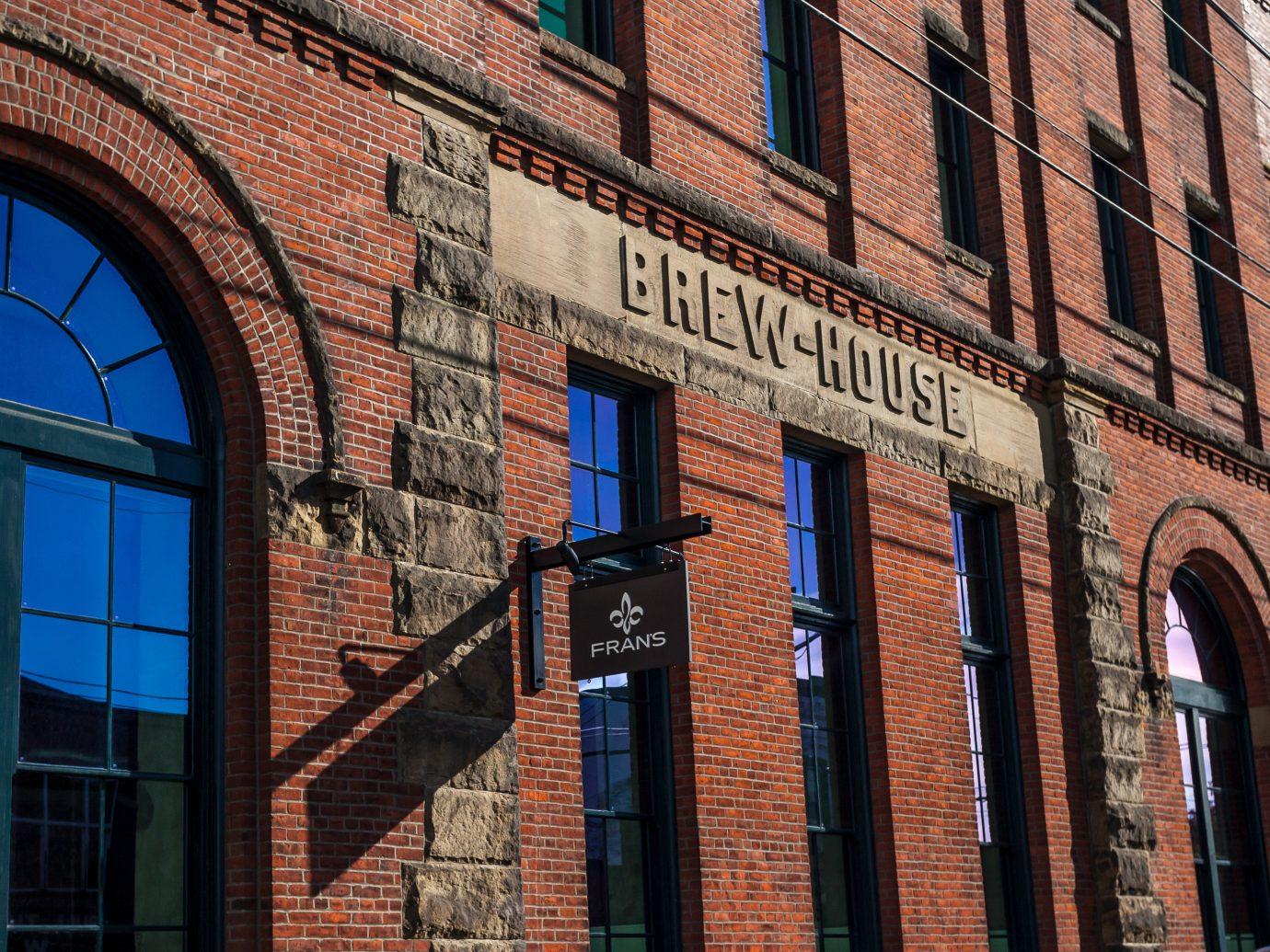 Food + Drink building brick outdoor Town City landmark urban area neighbourhood road Architecture human settlement wall Downtown facade street tall window synagogue