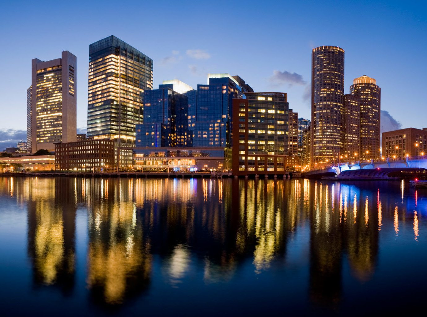 Architecture Buildings City Dining Hotels Shop Waterfront water sky outdoor River reflection skyline geographical feature landmark metropolitan area cityscape horizon night human settlement skyscraper metropolis urban area dusk evening Downtown Lake panorama distance