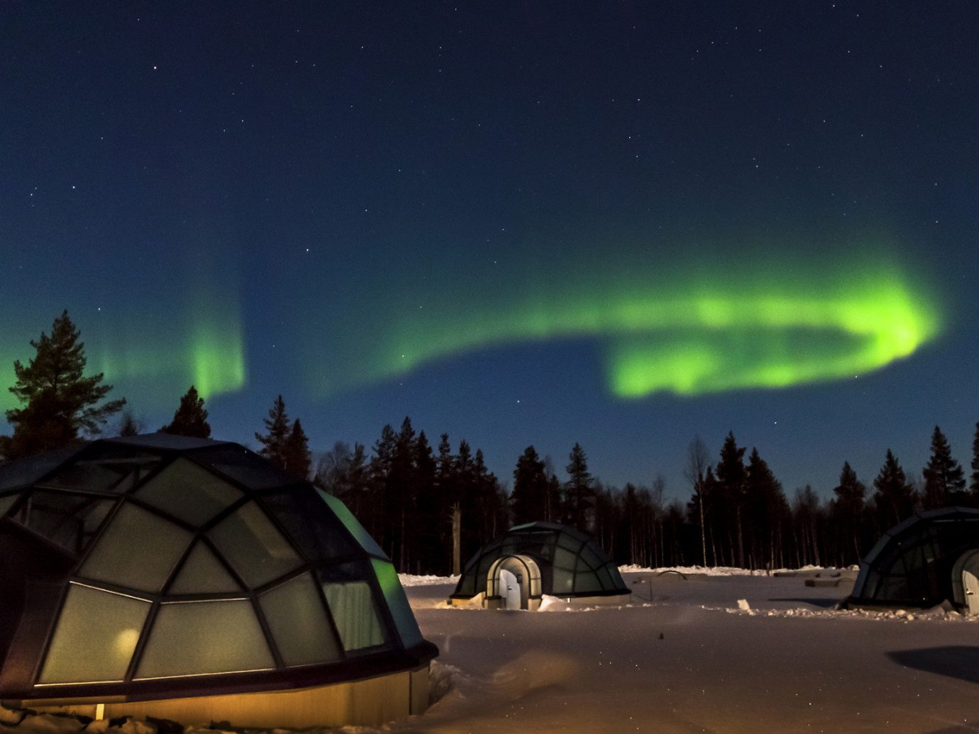 Hotels Offbeat Trip Ideas outdoor Nature sky aurora atmosphere atmosphere of earth phenomenon tree Winter landscape night computer wallpaper arctic space snow Night Sky
