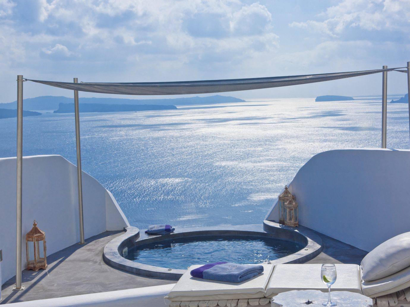 Hotels Luxury Travel sky water outdoor swimming pool Sea glass Ocean window vacation yacht Boat overlooking amenity leisure Deck day shore