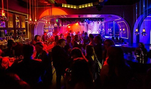 Hotels person scene nightclub night people club disco group crowd audience music venue light stage musical theatre Bar
