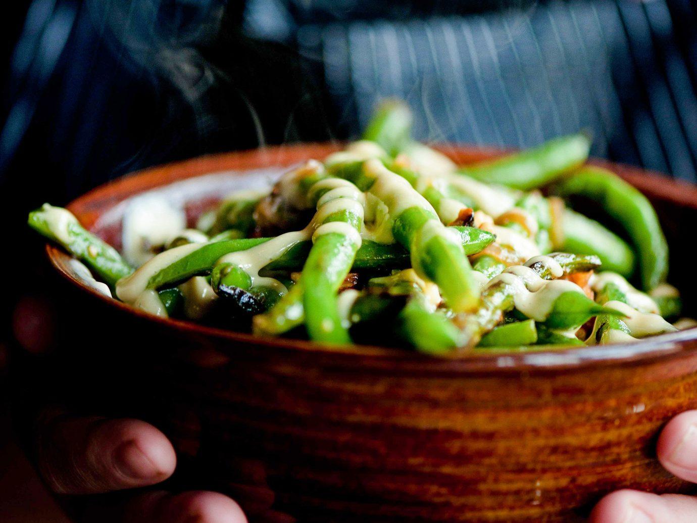 Food + Drink person food bowl indoor dish vegetable vegetarian food cuisine hand recipe asian food leaf vegetable