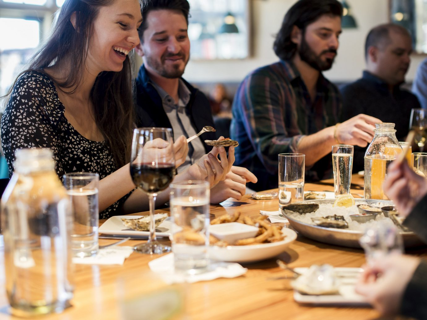 Trip Ideas person table sitting indoor meal lunch dinner people restaurant brunch sense supper dining table