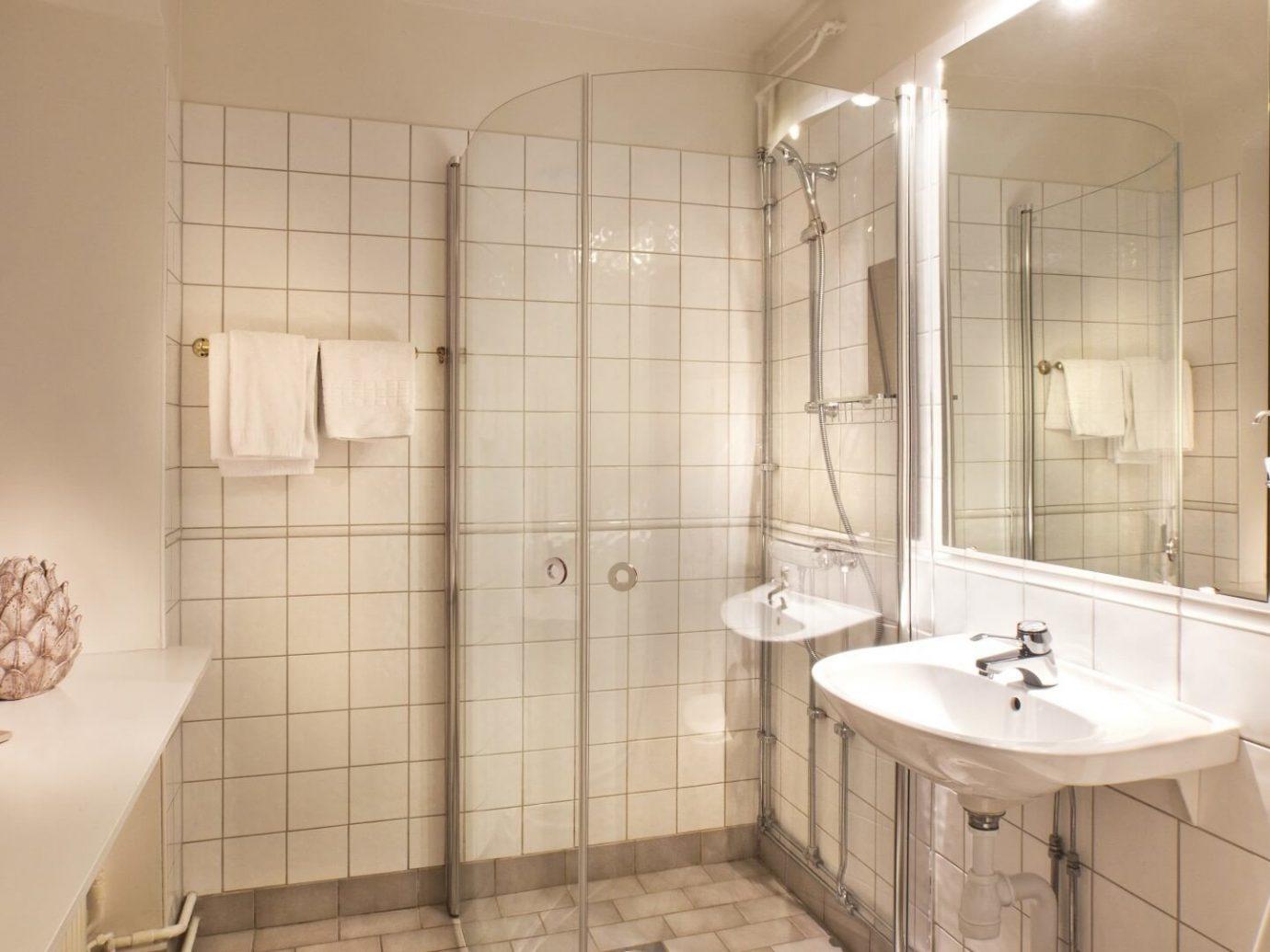 Denmark Finland Hotels Landmarks Luxury Travel Sweden bathroom indoor wall room property sink mirror interior design toilet home tile product design plumbing fixture floor interior designer tan tiled