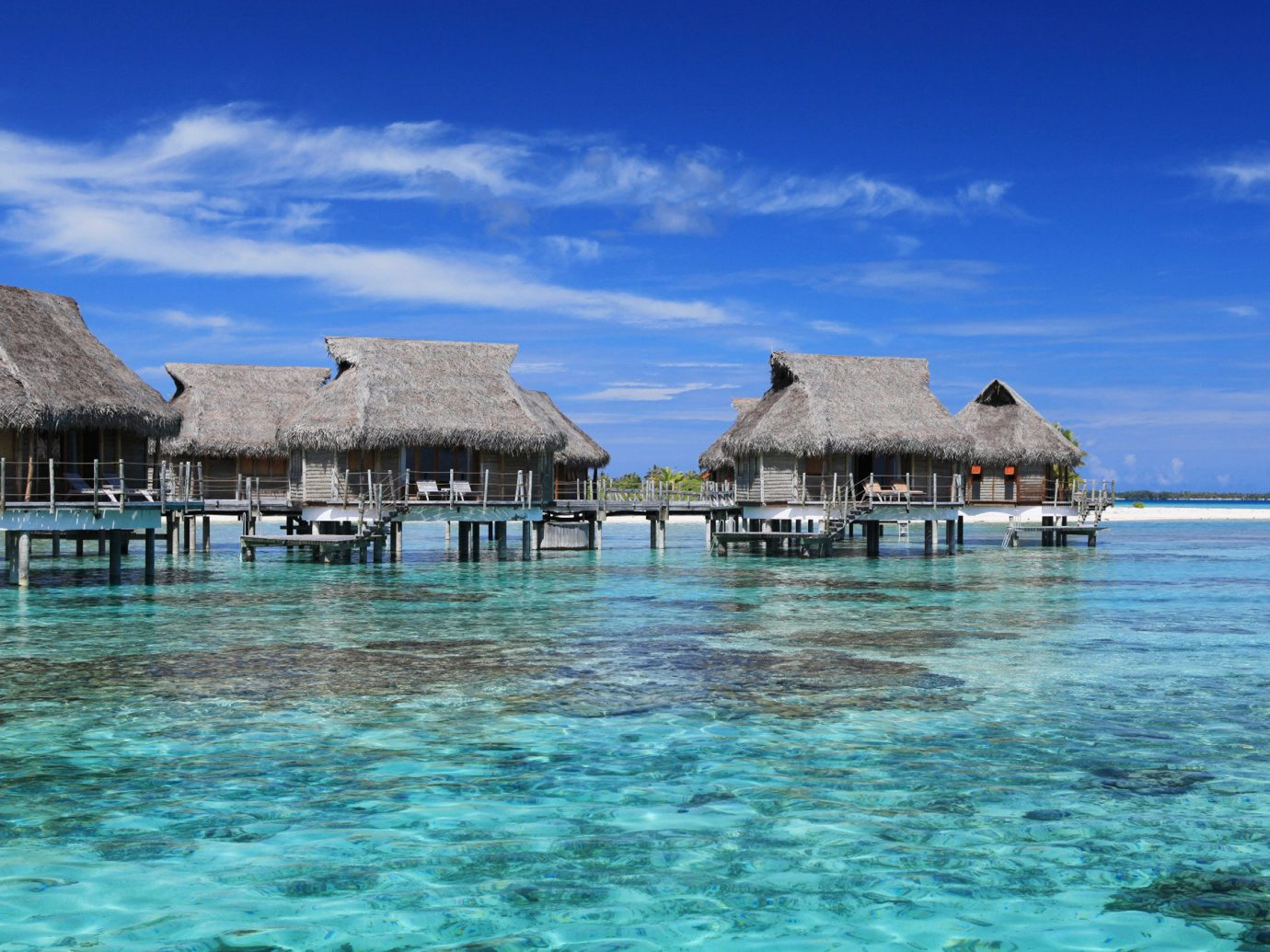 All-Inclusive Resorts Boutique Hotels Hotels Romance outdoor sky water umbrella Sea scene geographical feature landform chair body of water Ocean Beach vacation blue caribbean shore Coast Lagoon Island Resort bay Pool islet swimming pool cape lawn tropics cove swimming shade day sandy