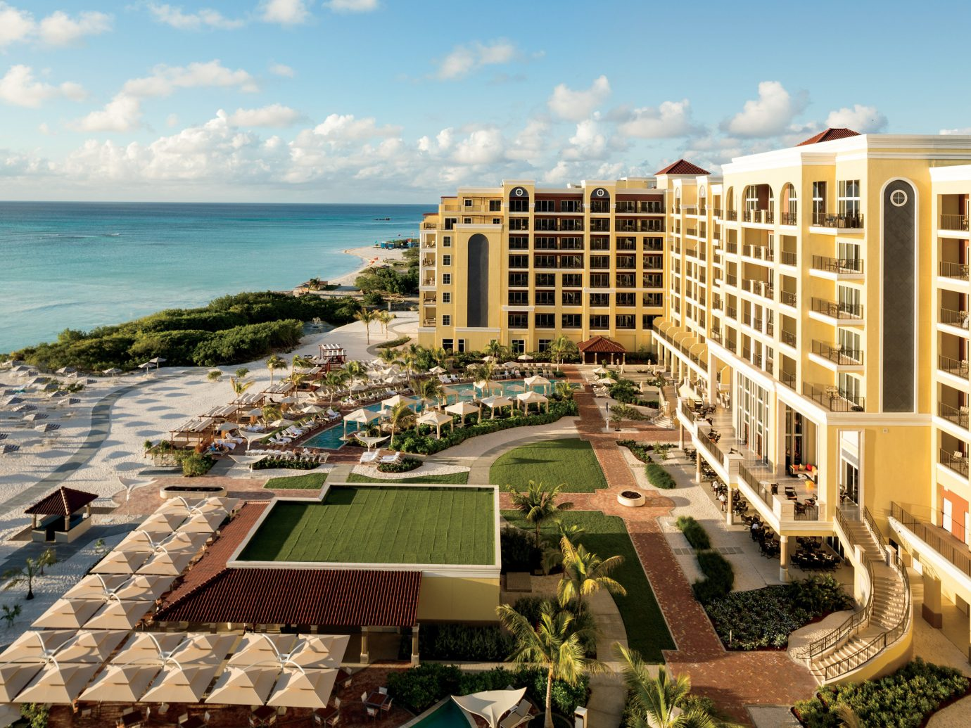 Aruba caribbean Hotels outdoor sky condominium property Resort mixed use real estate residential area hotel apartment vacation estate building City lawn shore sandy