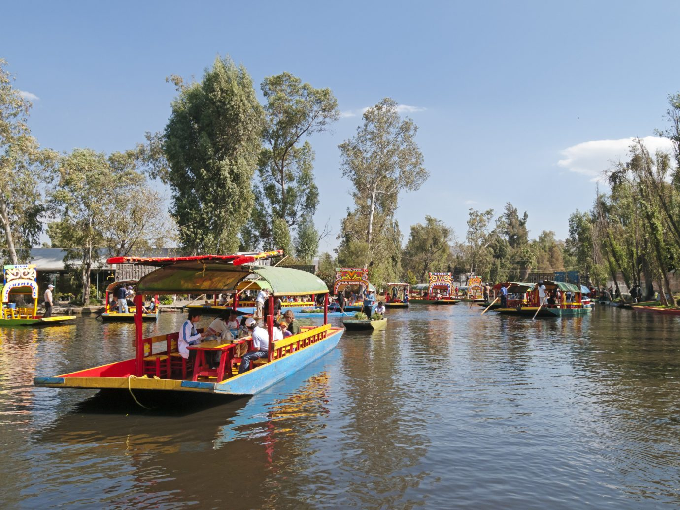Arts + Culture Mexico City Travel Tips Trip Ideas waterway body of water water transportation Boat Canal water plant boating tree River vehicle watercraft leisure bank recreation Lake landscape tourism bayou