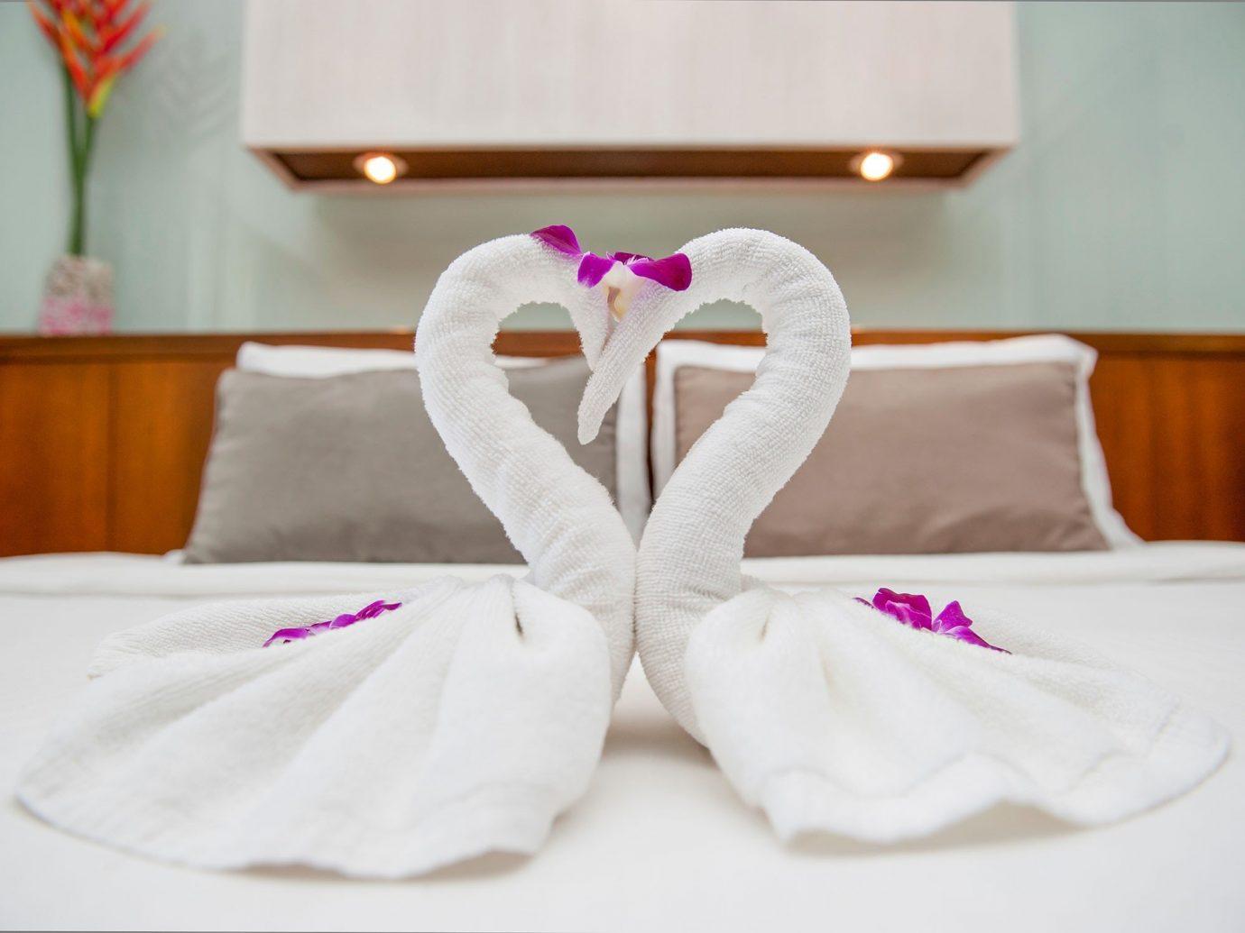 Offbeat indoor white pink product petal footwear cloth dress organ bed furniture textile flower