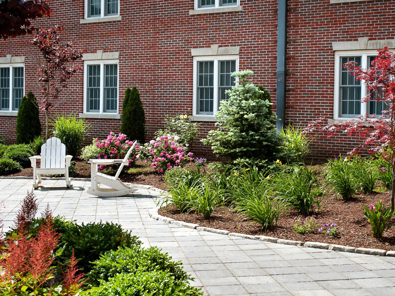 Classic Cultural Garden Grounds Hotels Outdoors Patio building outdoor house brick walkway property yard wall backyard flower Courtyard lawn home residential area landscape estate landscape architect real estate landscaping shrub stone