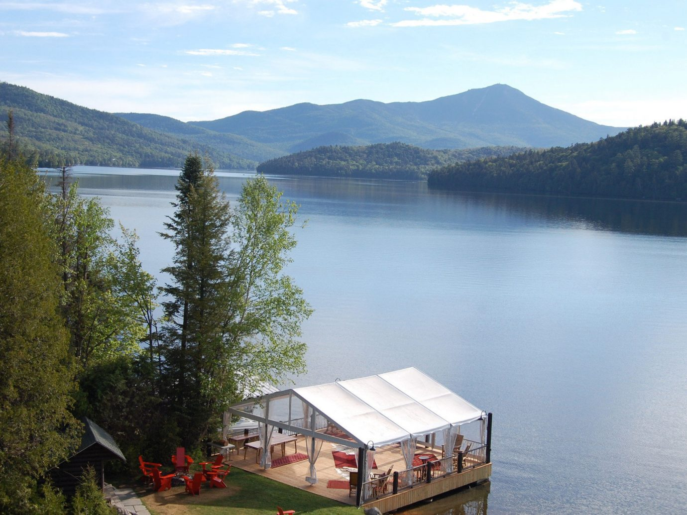 Hotels Lake Lakes + Rivers Lodge Mountains Nature Outdoors remote Scenic views trees view viewpoint mountain outdoor water tree sky body of water loch house fjord reservoir reflection mountain range background surrounded traveling hillside shore