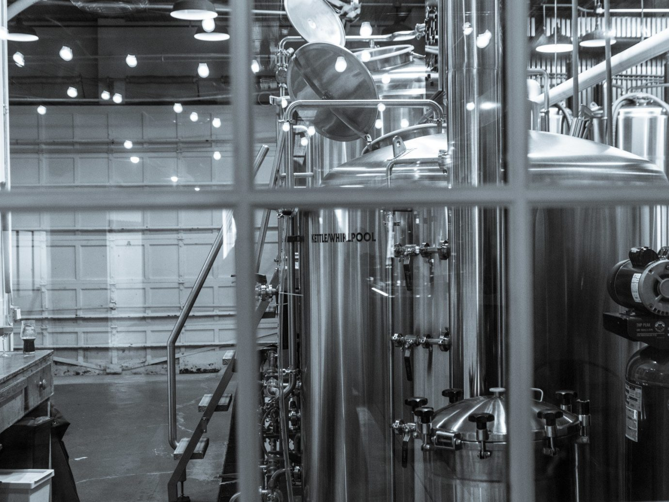 Food + Drink indoor room iron factory manufacturing monochrome brewery industry glass