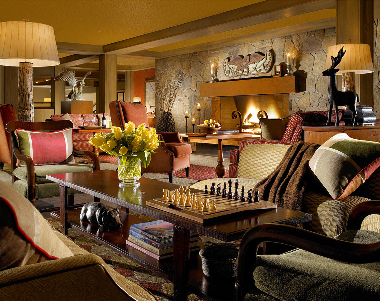 Country Fireplace Inn Lobby Lounge Resort Weekend Getaways indoor living room room Living property home estate interior design dining room furniture Suite recreation room decorated area several cluttered