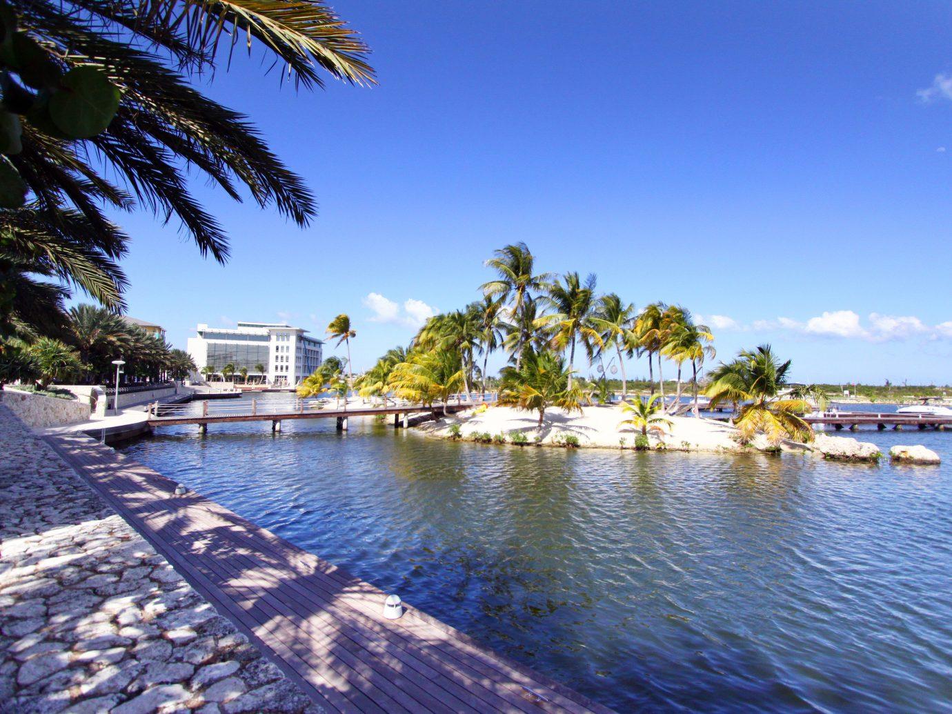 Trip Ideas outdoor tree water sky River swimming pool marina Resort Sea vacation dock Beach bay estate Coast arecales Lagoon Lake docked shore surrounded