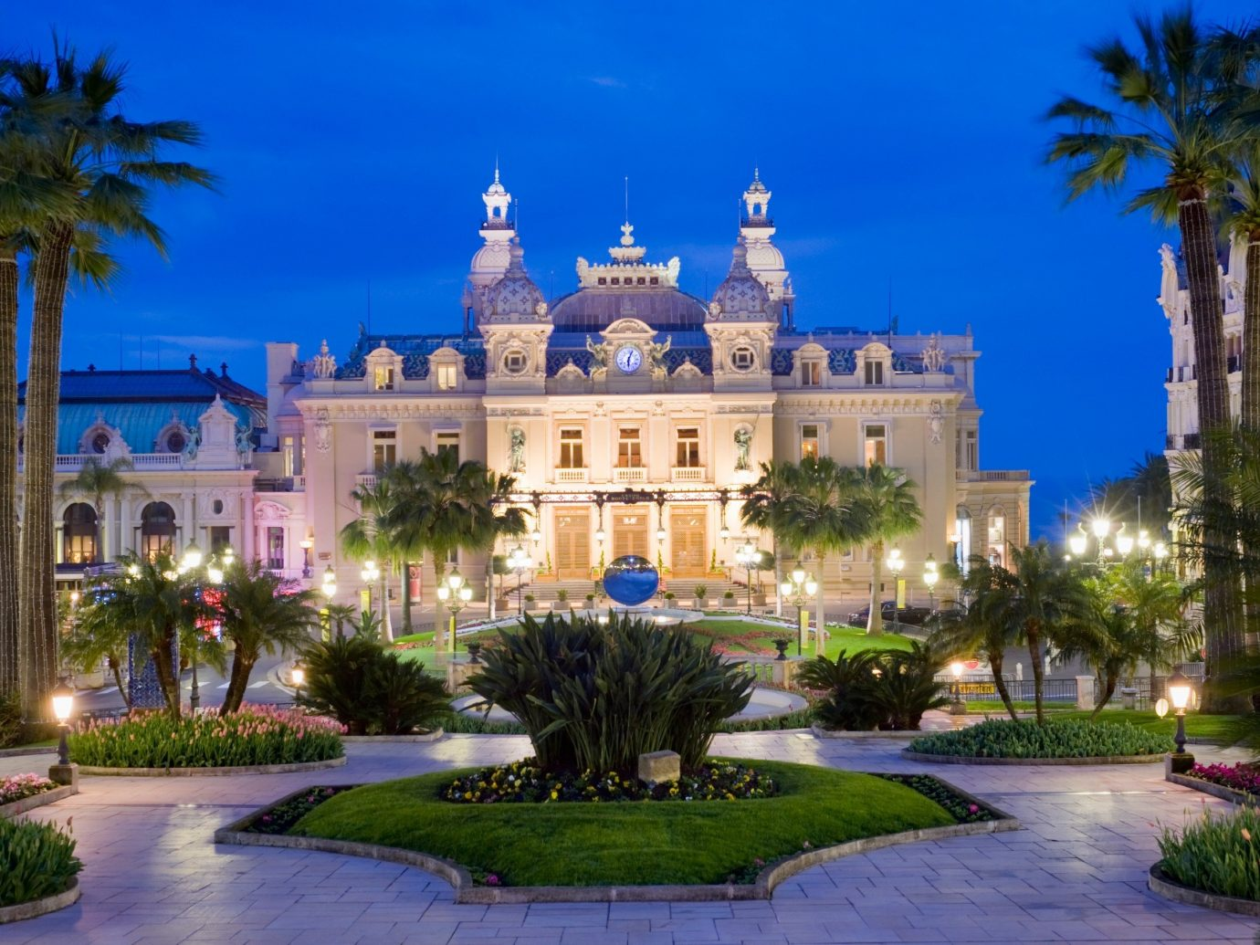 Hotels tree outdoor sky building plaza landmark estate Resort palace mansion tourism light park town square government building Garden surrounded