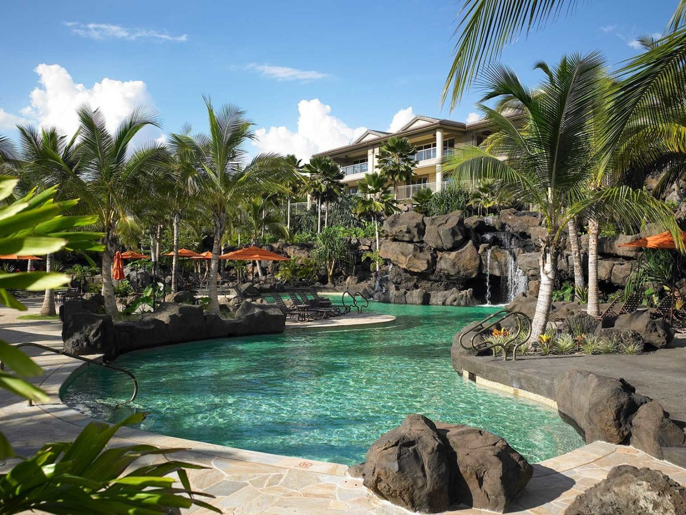 Beach Boutique Hotels Hotels Luxury Travel Trip Ideas tree outdoor Resort swimming pool vegetation arecales water palm tree tropics leisure plant Nature vacation real estate tourism resort town sky estate Lagoon landscape recreation palm shore