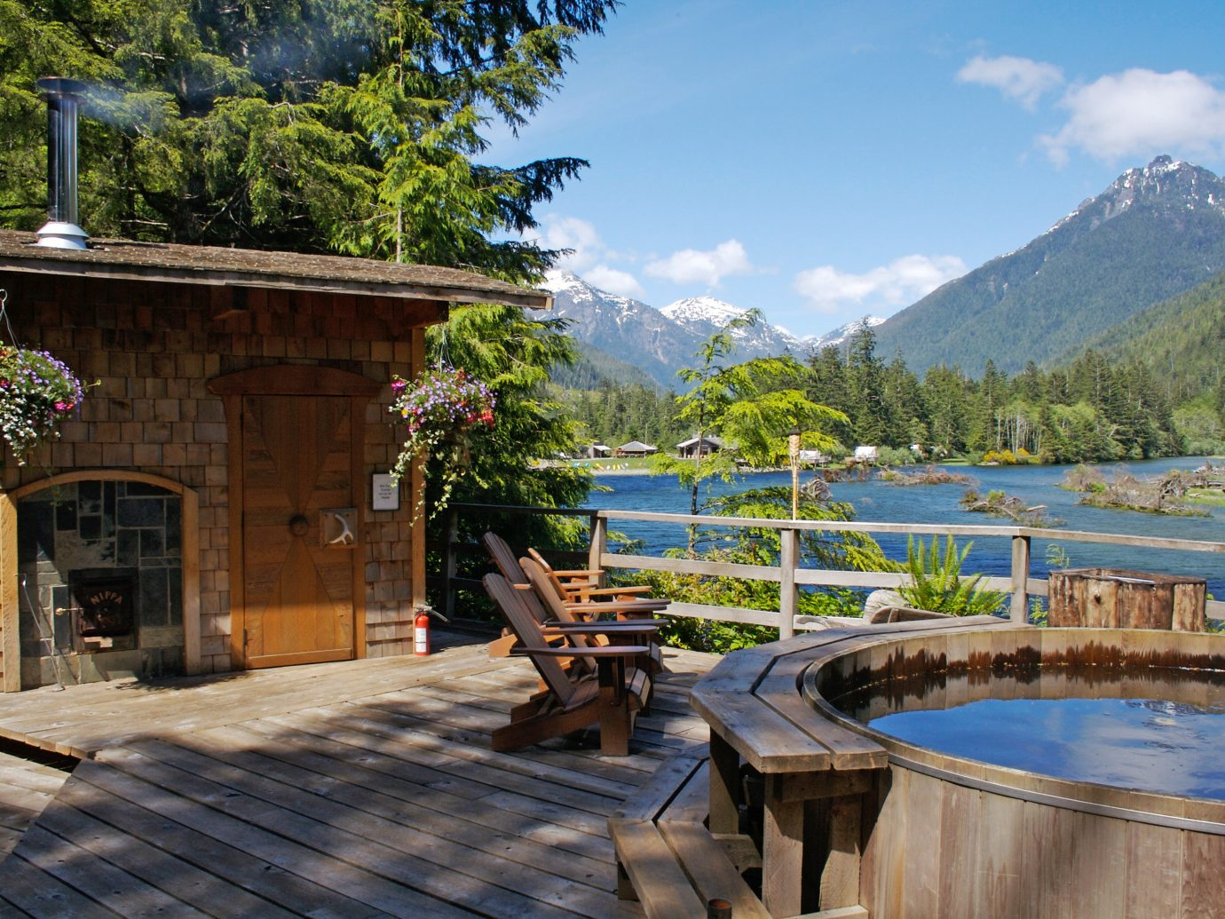 Adventure Deck Family Glamping Hot tub/Jacuzzi Luxury Travel Mountains Outdoors Play Romantic Rustic Scenic views Trip Ideas Waterfront Wellness outdoor tree mountain leisure estate vacation Resort swimming pool tourism Village backyard cottage