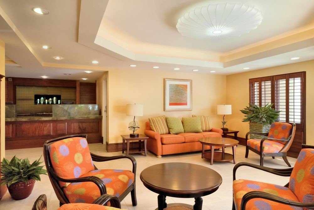 Florida Hotels indoor ceiling wall room floor Living chair furniture window living room property estate condominium real estate home interior design Suite Lobby area leather decorated