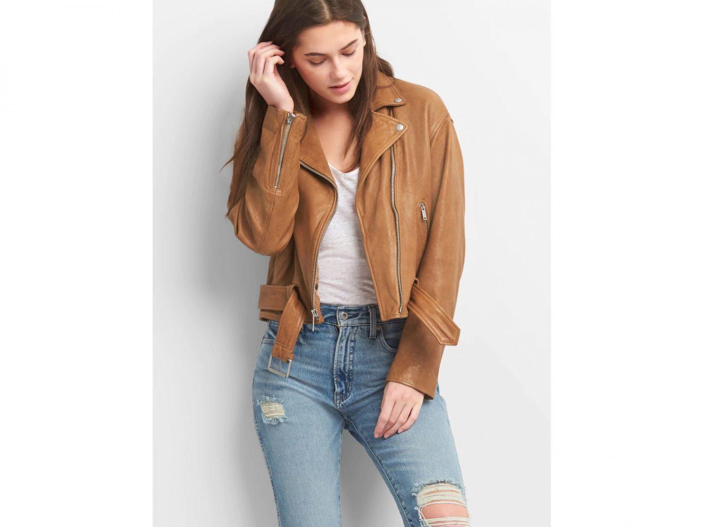 Packing Tips Style + Design Travel Shop clothing person jacket fashion model leather jacket jeans posing sleeve leather waist neck beige denim trouser