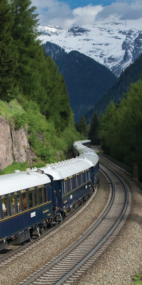 Luxury Travel Trip Ideas train track tree outdoor mountain grass transport traveling vehicle rail transport rolling stock mountain range long Forest engine moving area wooded lush