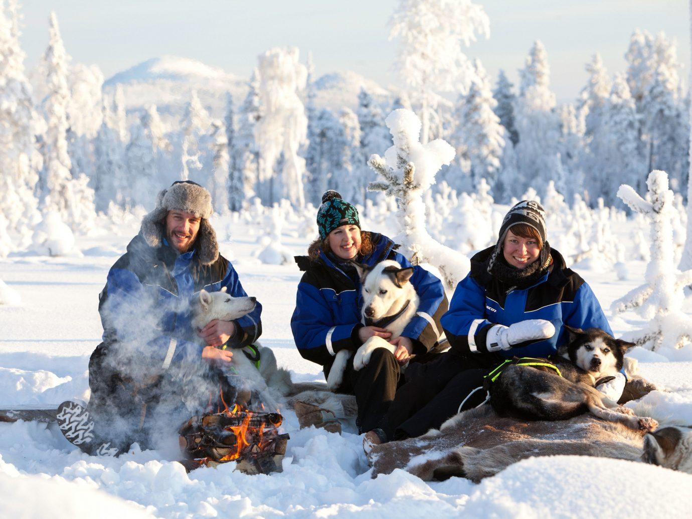 Trip Ideas snow outdoor Dog person Winter transport vehicle season people footwear sled winter sport sledding snowshoe posing