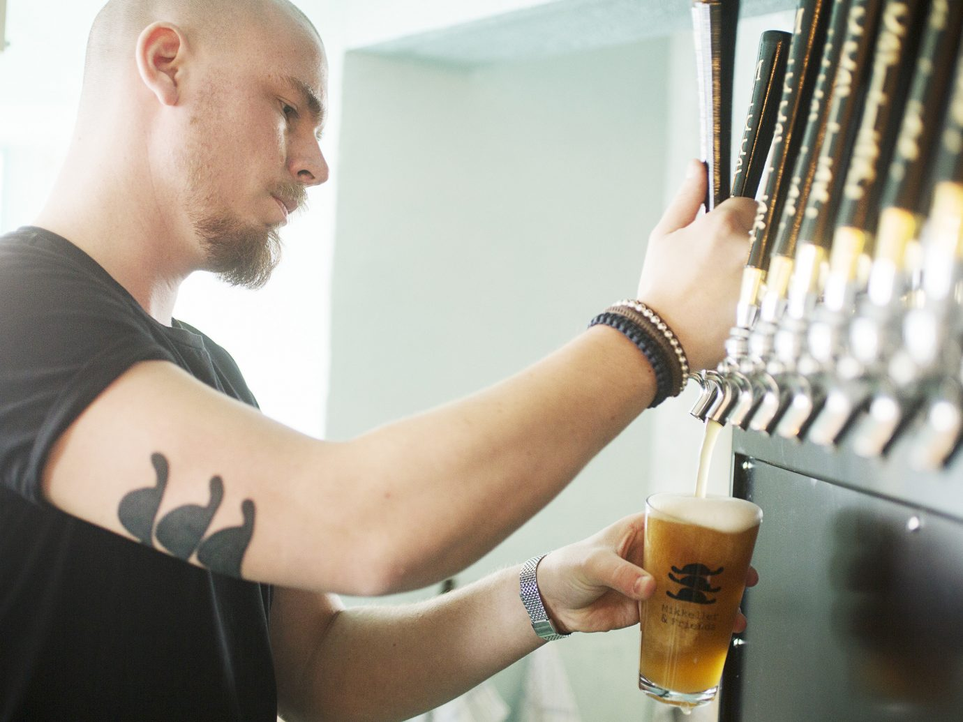 Copenhagen Denmark Trip Ideas person indoor Drink shoulder arm alcoholic beverage muscle distilled beverage liqueur beer neck alcohol