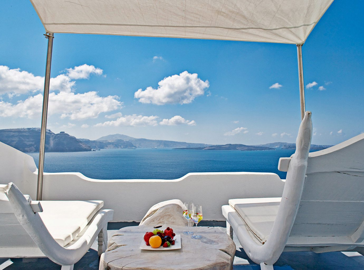 Balcony Bedroom Classic Elegant Hotels Island Luxury Romantic Scenic views Trip Ideas Waterfront sky blue outdoor room vacation Sea wind day