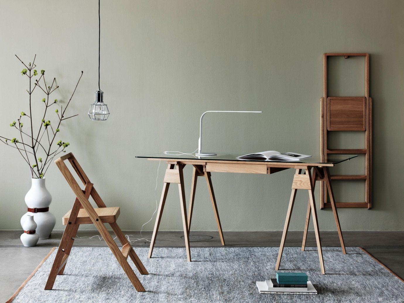Jetsetter Guides wall indoor chair furniture room desk table floor wood interior design dining room Design